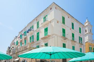 Molfetta, Apulia - Turquoise sunshades and lattice blinds in the streets of Molfetta