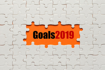 Wall Mural - Goals 2019. White details of puzzle on orange background