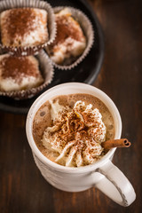 Christmas hot chocolate with whipped cream and cookies