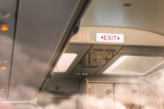 Fire exit sign on airplane in fire situation, Selective focus.