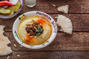 Humus with fried meat and spices, copy space