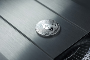 Ethereum Silver coin lies on the metallic shiny surface