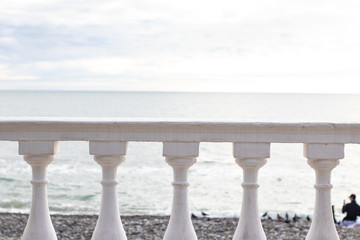 White parapet on the seafront overlooking the sea