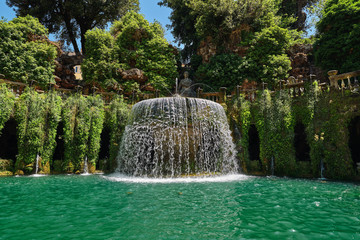 Magnificent fountain with turquoise water in the park of the Villa d'Este in Tivoli