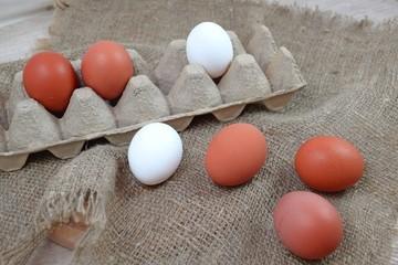Fresh eggs on burlap.
