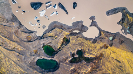 Aerial view of a glacier's surroundings with natural shapes