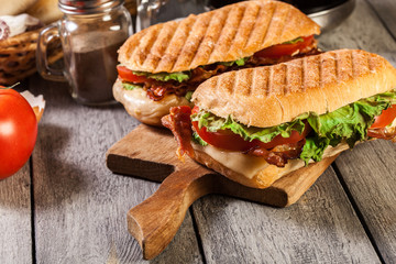 Toasted ciabatta sandwich with smoked bacon, cheese and tomato