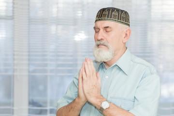 Bearded pensioner in the Tatar national skullcap.