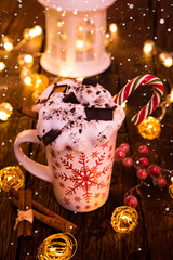 Christmas cup with hot chocolate and whipped cream.