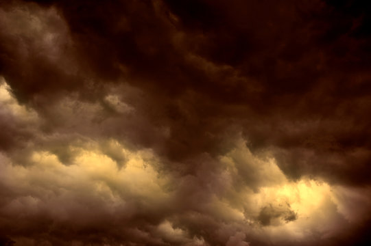 RED AND GOLD DARK THUNDERY STORM CLOUDS IN SKY