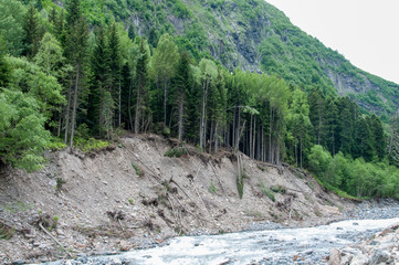 Closeup view mountains and river scenes in national park Dombai, Caucasus, Russia, Europe.