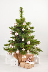 Decorated christmas tree with wrapped gifts. Christmas and new year celebration concept