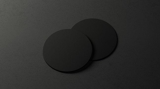 Blank black two beer coasters mockup set on dark surface