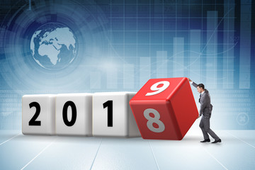 Businessman employee rotating cube to reveal number 2019