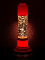 Glitter lava lamp with light behind. Genuine vintage 1970 edition, red orange colour.