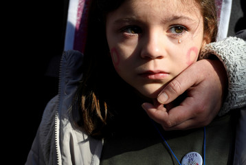 A girl cries during a rally against gender-based and sexual violence against women in Gijon