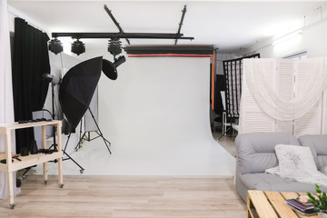 Empty photo studio with professional lighting equipment