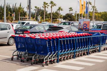 Estepona, SPAIN - MAY 2018:Shopping carts at the parking lot near the supermarket
