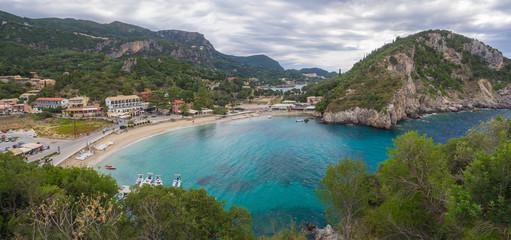 Panoramic view on beautiful Paleokastritsa bay with sand beach, forest, hills and rocks, Corfu, Kerkyra, Greece
