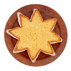 Star shape slice of pandoro, Italian sweet yeast bread, traditional Christmas treat. Overhead flat lay view. Isolated on white.