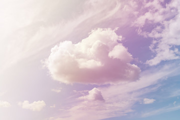 Fluffy cloud against a gently violet sky (background)