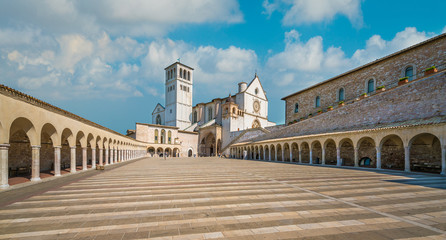 Saint Francis Basilica in Assisi on a sunny summer day. Umbria, central Italy. Wall mural