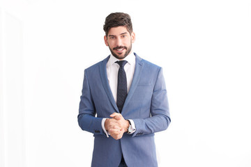 Businessman standing at isolated white background and wearing suit