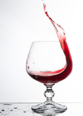 A glass of white wine on white background close up still life image