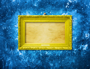 Old vintage multicolored ornate frame for picture on  wall