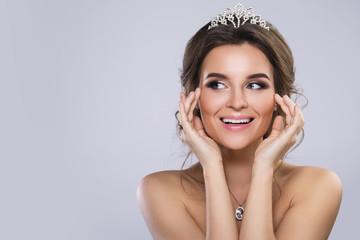 Portrait of young beautiful bride wearing diadem