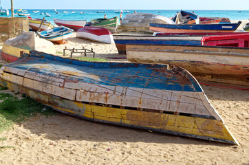 Old boats on the beach of Sal, the island of Cape Verde