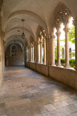 Cloister with beautiful arches and columns in old Dominican monastery in Dubrovnik