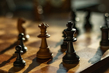 Queen and king: chess pieces on a board