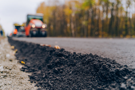 Close view on the new road construction site. Close-up asphalt at the road under construction. Asphalting