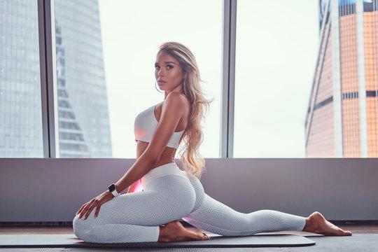Beautiful girl wearing sportswear doing yoga exercise.