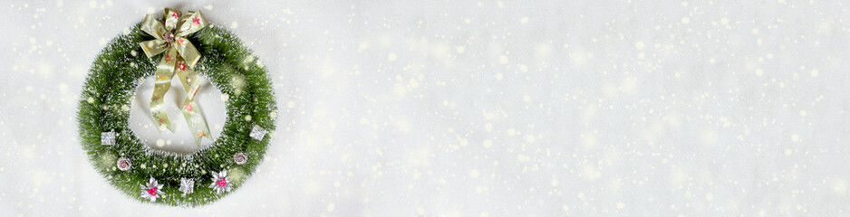 Christmas wreath isolated on beige background snow flakes