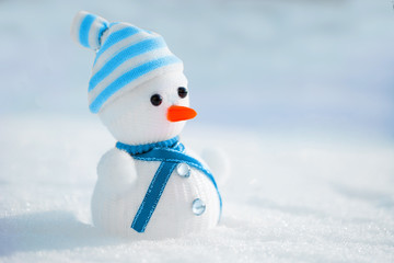 Snowman in the snow. Winter time scene.