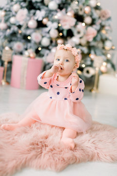 house. bedroom. room a little girl. Very beautiful girl playing on the floor. Xmas holiday concept