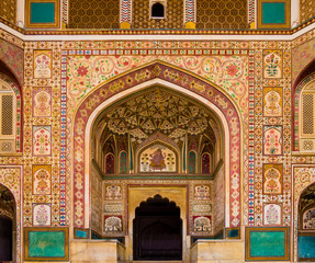 Stunning facade of Ganesh Pol entrance in Amber Fort Palace, Jaipur, Rajasthan, India