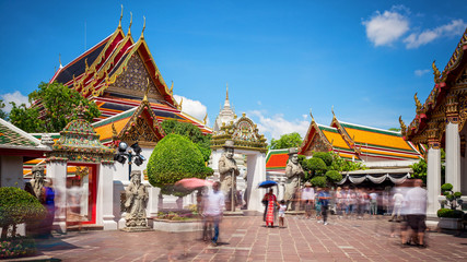 Wat Pho Temple and Tourists in Bangkok, Thailand