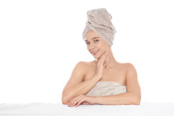 Portrait of young pretty woman with towels on white background