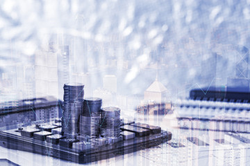 Double exposure of coin stack and financial graph paper sheet with calculator, city background, business planning vision and finance analysis concept
