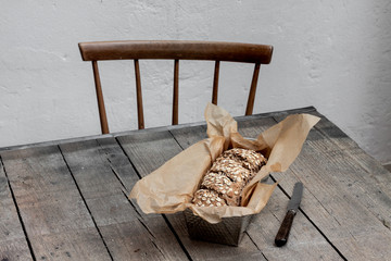 Homemade wholegrain bread on a rustic table with chair
