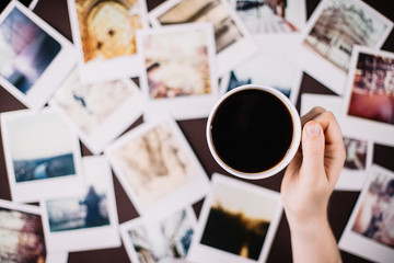 Coffee over polaroids