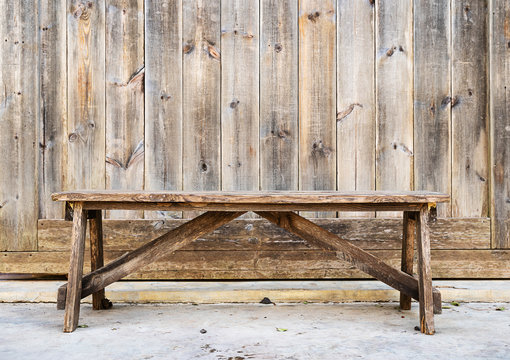 Wood bench against  wood plank wall