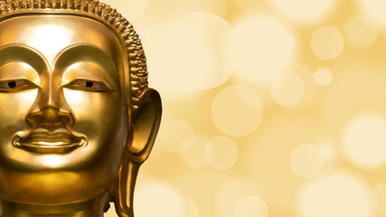 Golden Buddha face on golden abstract background