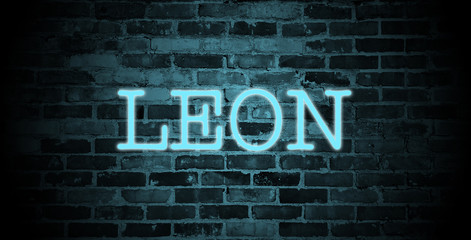 first name Leon in blue neon on brick wall