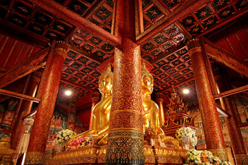 Impressive Four-sided Seated Buddha Images with Gorgeous Lacquered Teak Wood Pillars in Wat Phumin Temple, Nan Province, Thailand
