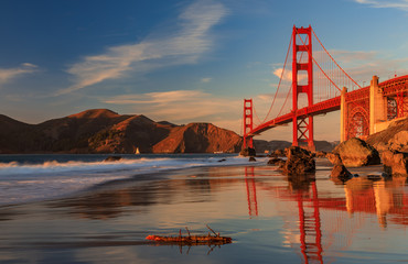 Golden Gate Bridge view from the hidden and secluded rocky Marshall's Beach at sunset in San Francisco, California