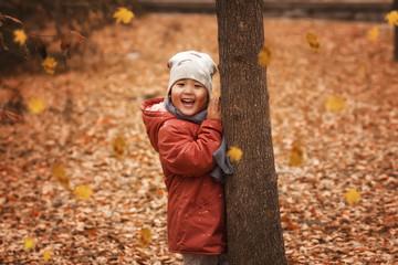 Pretty little girl in autumn park Wall mural